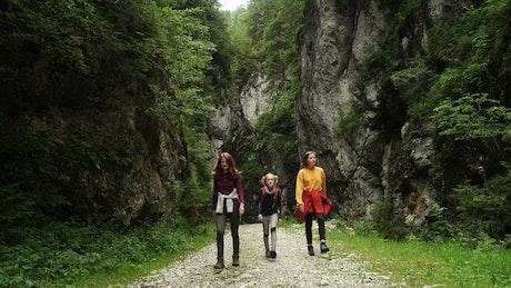 Women hiking on a mountain path