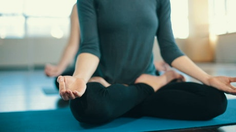 Women in yoga and meditation class