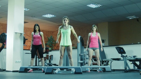 Women jumping and making exercise