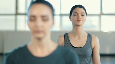 Women meditating in yoga class