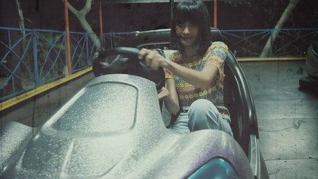 Women playing with bumper cars