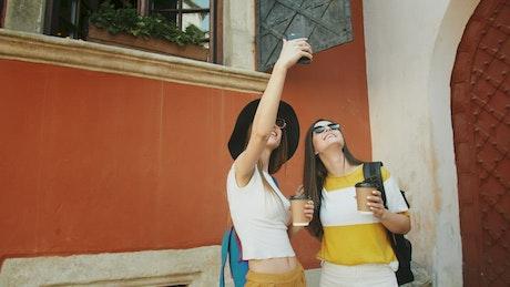 Women take video selfie for social media