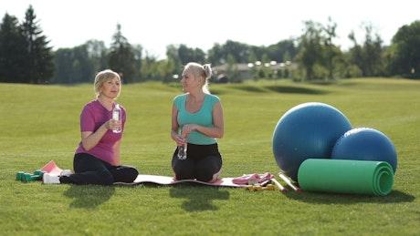 Women taking a break from Yoga