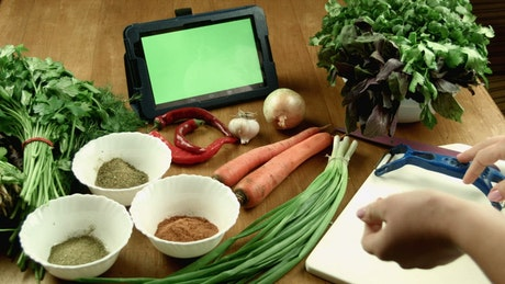 Women watching a recipe on a tablet device