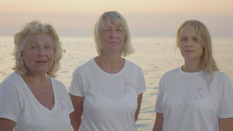 Women wearing the Breast Cancer ribbon