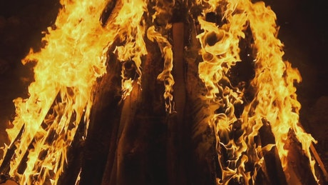 Wood logs burning in flames at night
