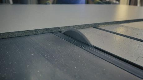 Wood splitter cutting a board