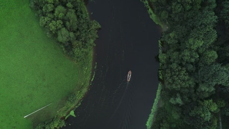 Wooden boat sailing in the river