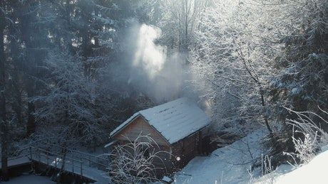 Wooden hut in the winter forest