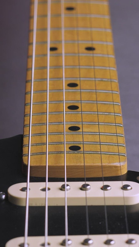 Wooden neck of an electric guitar