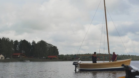 Wooden sailboat floating on a lake