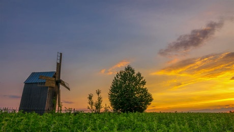 Wooden windmill at sunset