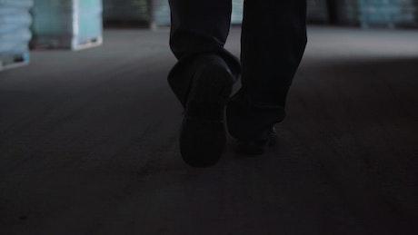 Worker man walking in a warehouse