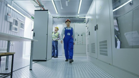 Worker walking in the hallway of energy station