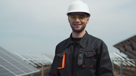 Worker with a security helmet smiling and modeling