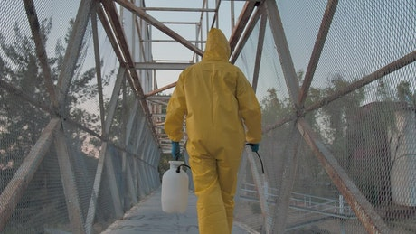Workers disinfecting a bridge