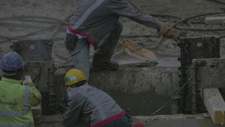 Workers welding in a yard
