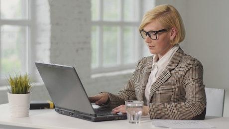 Working woman suffers from eye or headache pain