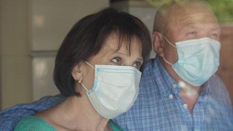 Worried couple wearing facemasks