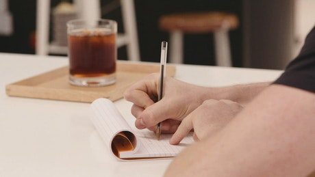 Writing notes at a cafe