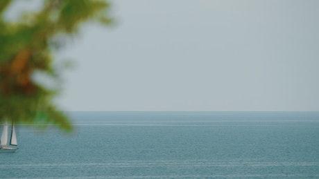 Yacht heading across a calm sea