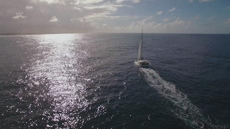 Yacht sailing towards a storm