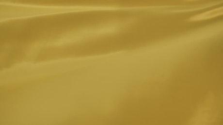 Yellow fabric waving slowly