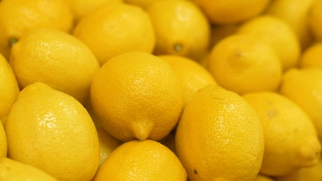Yellow lemons in a market, close up