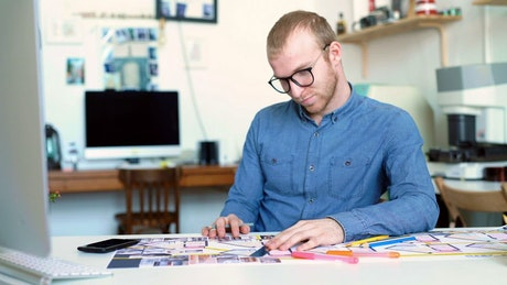 Young architect works concentrated on a blueprint