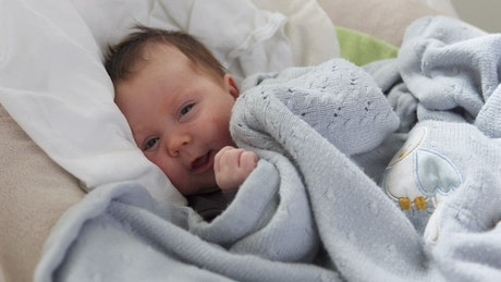 Young baby in blankets