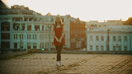 Young ballerina training in the rooftop