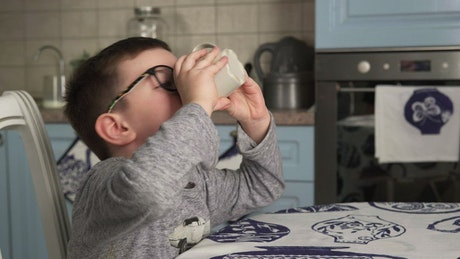 Young boy drinking from a cup