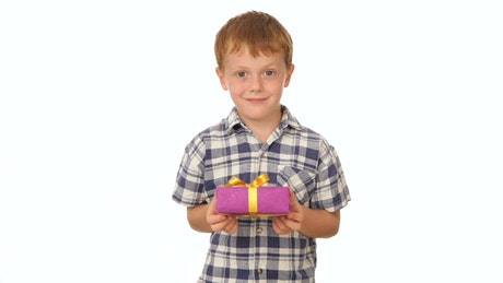 Young boy holding a gift