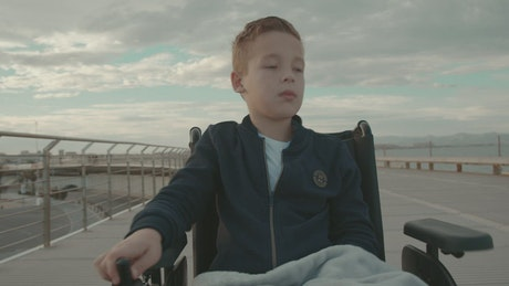 Young boy in an electric wheelchair