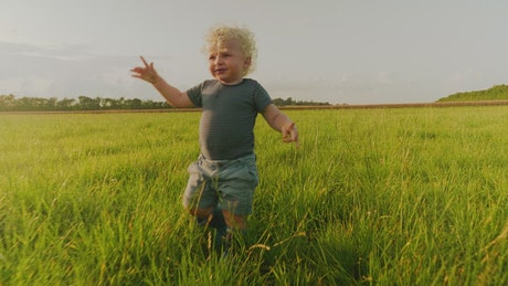 Young boy out in the countryside