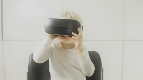 Young boy with a VR headset
