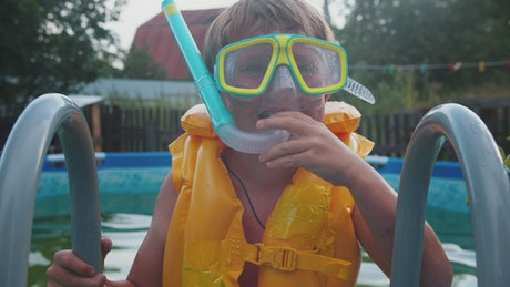 Young boy with inflatable vest and snorkel equipment