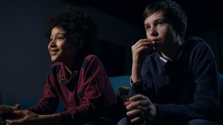 Young boys watching a funny film