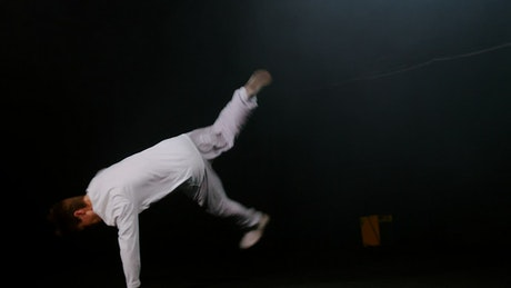 Young break dancer performing in white clothes