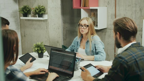 Young business team discuss design in modern office