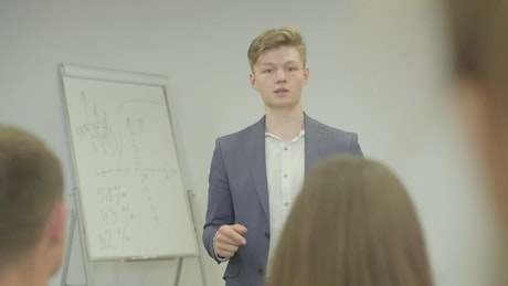 Young businessman gives seminar to peers