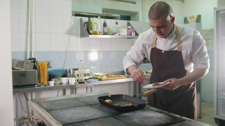 Young chef preparing a meal in the kitchen