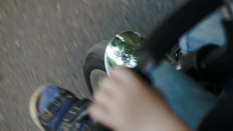 Young child riding a small bike