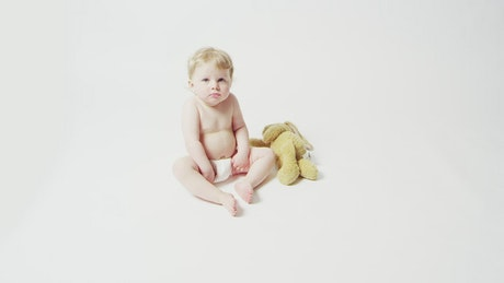 Young child sitting down
