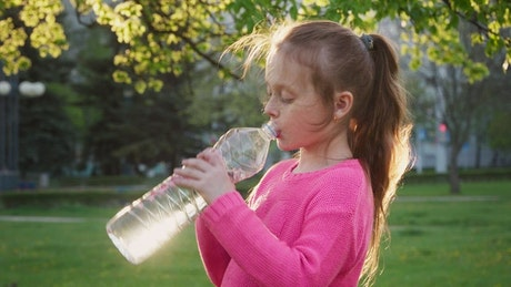 Young child with a water bottle