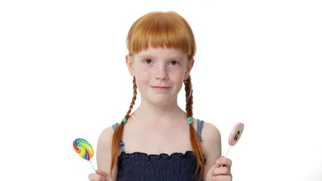 Young child with two candy sticks