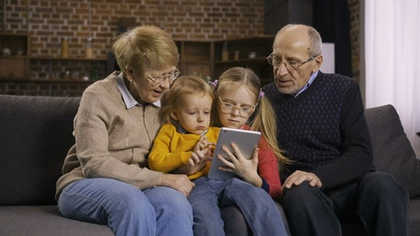 Young children with their grandparents