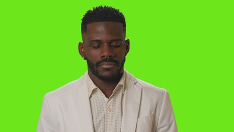 Young confused and thoughtful man on a chroma background
