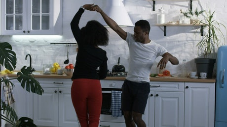 Young couple dancing in the kitchen
