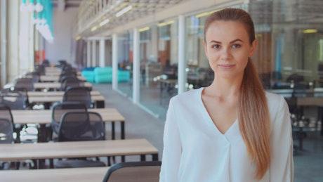 Young enterprising woman smiling confident